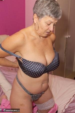 Hot granny Savana peels to display her tones body and nice big boobs
