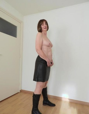 Hot old woman Kat Kitty puts her trimmed vagina on display in solo action