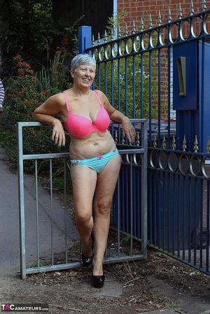 Brazen hot mature granny Savana poses outdoors in her gorgeous lingerie