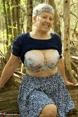 Bold old granny Savana shows off her tremendous saggy boobs in the forest