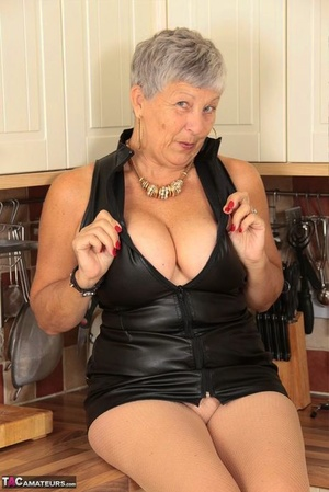 Kinky oma pulls down her pantyhose after freeing her large mounds