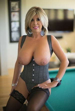 Blonde Mummy with big suntanned tits in stockings and corset facialized after bj