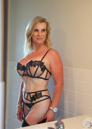 Luxurious mature blonde Sammi Rox in sheer lace lingerie toying pussy close up