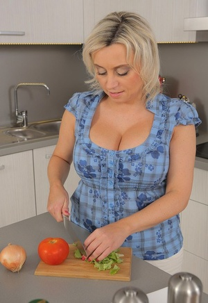 Housewife Sindy Huga plays with gigantic orbs and fingers chubby pussy in kitchen