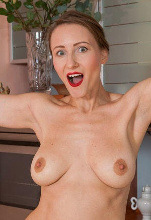 Hot housewife Alena K peels to stretched naked bootie & masturbate in the kitchen