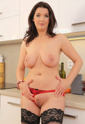 Mischievous housewife Fernanda Jerson enjoys a cucumber insertion with her wine