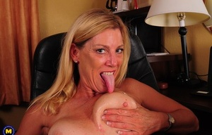 Blonde house for the USA parts her pink cunt after getting naked in her office