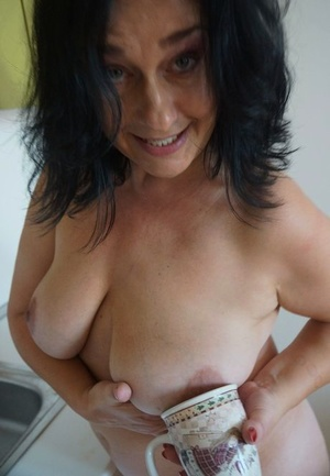 Older housewife Ria Black strips after washing up dishes to finger her pussy