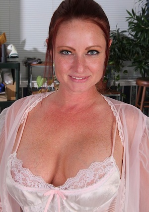 Mature housewife Brandie Jones slides vibrator up her pussy in white stockings
