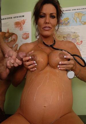 Charming mature preggo Nancy milks a hard cock and her lactating tits