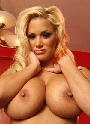 MILF pornstar Shyla Stylez touts her utter breasts in black boots
