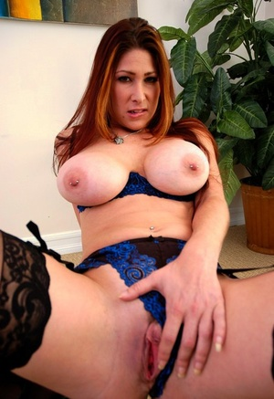 Big-chested MILF Tiffany Mynx showing off her ass attired in black pantyhose