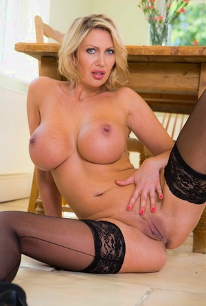 Blonde female Leigh Darby takes off sheer lingerie to model in ebony tights