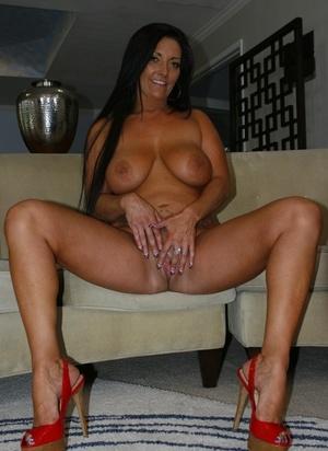 Mature female Sammy Brooks unleashes her big bra-stuffers as she gets naked