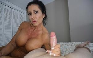 Mature mom Mrs Simone jacks off a big rod in the nude while masturbating