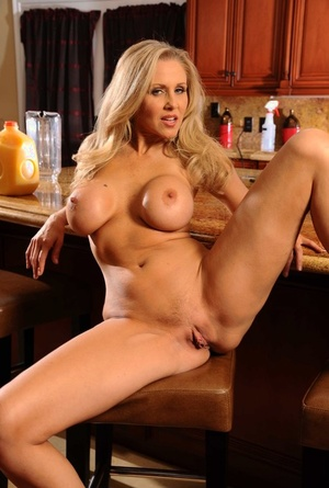 Blonde mom Julia Ann bakes a plate of cookies before modeling nude