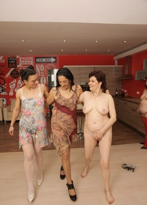 A number of older and younger females pair up for lezzie sex