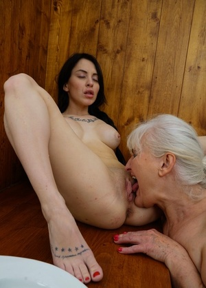 Old and young lesbians Juliene and Kaitlyn pleasure each other's slits