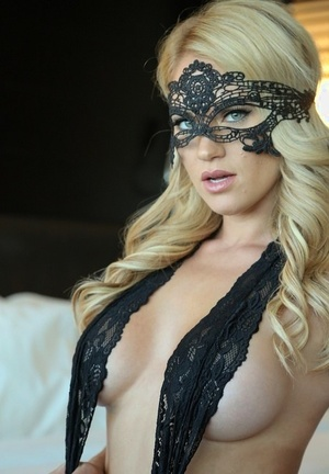 Sexy towheaded Shannyn Xo models non bare in lingerie and masquerade mask