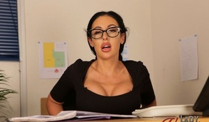 Horny secretary Mila Amora exposes upskirt panties while at her desk