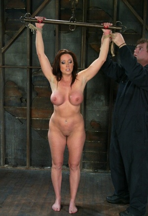 Plump lady Christina Carter feels the weight of nipple clamps on her big tits