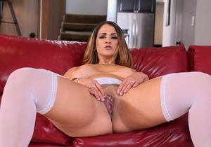 Curvy solo model Miss Raquel flaunts her big butt in white nylons and garters