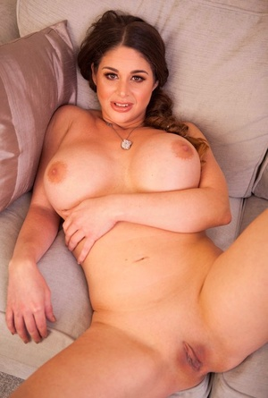 Big orb MILF Cathy Heaven displays her cock hungry pussy on the sofa