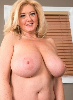 Massive boobed granny Tahnee Taylor sucks off her young lover's big dick
