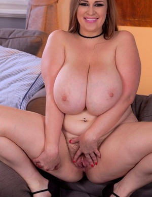 BBW Smiley Emma decorates her massive boobs with milk after disrobing