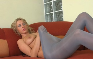 Tall blonde Dorota bares her tits before slipping opaque hose pipe over her ass