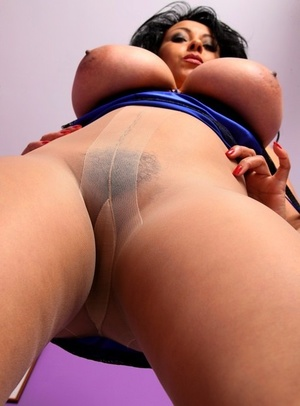 Older solo model Danica Collins pulls own pantyhose prior to jerking
