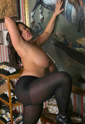 Polish solo girl Aneta Buena releases her huge tits in black pantyhose