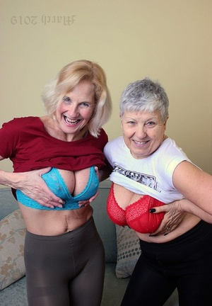 Old lesbians suck on each others boobs after modeling fully clothed