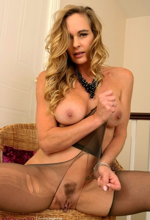 30 plus lady Elegant Eve uncovers her boobs before ripping open pantyhose