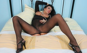 Mature model Eve bares her big tits while touting her sexy ass in assless hose