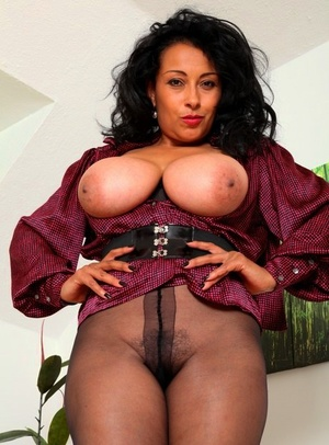 Older solo model Danica Collins shows her fat tits and bush in hose and boots