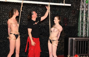 Tall caucasian females Cobie & Spring are suspended upside down by cords