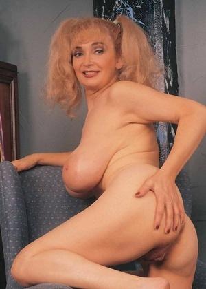 Platinum-blonde mature woman liquidates sheer dress showing bare culo & huge saggy tits