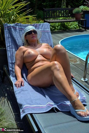 Sexy mature Chrissy models firm big bra-stuffers & chubby nude body on and by the pool