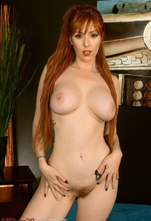 Sexy redhead Lauren Phillips removes steamy undergarments to model totally naked