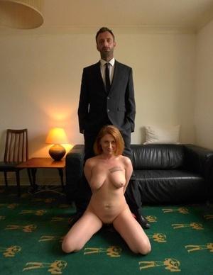 Natural redhead Princess Paris displays her big natural tits once nude