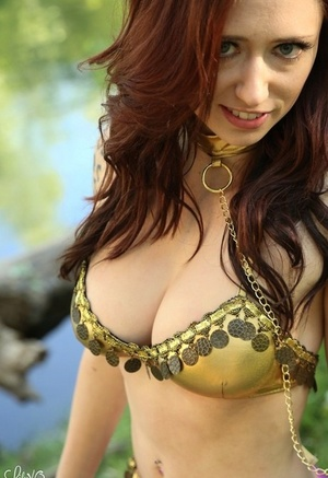 Inexperienced model Lily Xo sets her hot donk free off belly dance attire by a sea