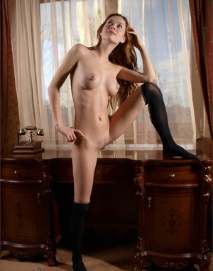 Buxomy hot redhead poses naked for closeup nipples & naked ass shots