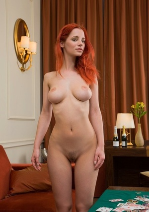 Hot redhead Ariel removes clothes after losing at poker & rolls in the chips
