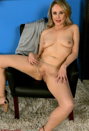 Older MILF Elle Mcrae uncovers big naturals as she undresses to high heeled footwear