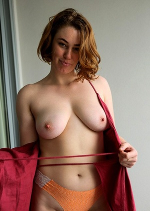 Redhead amateur Molly Broad sits on a dildo after getting naked