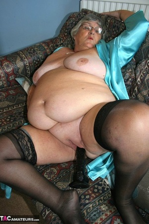 Old female with a saggy melons and a fat belly pleasures herself with a dildo