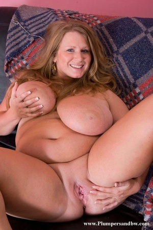 Plumper with strawberry blonde hair and giant bra-stuffers showcases her bald pussy