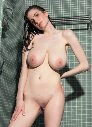 Busty brunette Lillian Faye removes wet shirt and see thru panties in shower