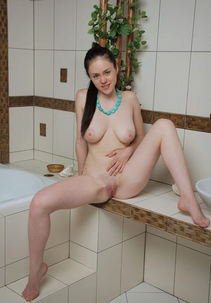 Young and busty dame Annis A showcases her smooth cunny in the bathroom